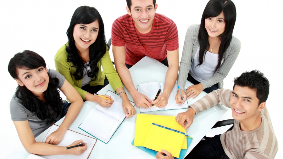 Group of students studying together seen from above